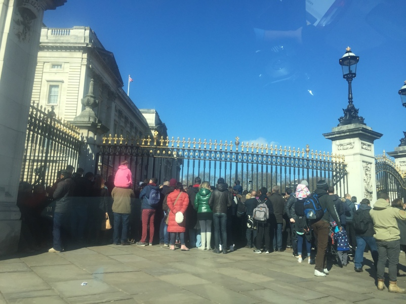 Citizens and tourists outside the Buckingham Palace waiting for Changing the Guards ceremony